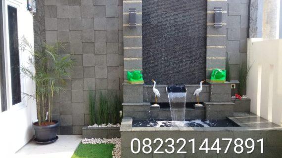 Jasa pembuatan kolam minimalis batu alam dan tebing relief